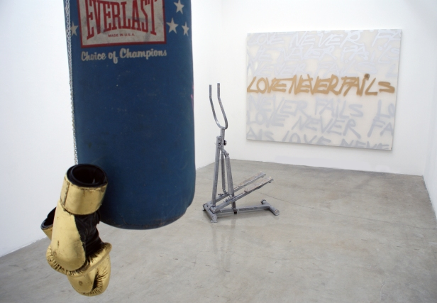 """Risk"" 2011 (Installation materials: punching bag, gold leaf, boxing gloves, embossed stair-stepper, spray-can on canvas.)"