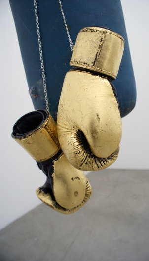 """Risk"" 2011 (Installation materials: punching bag, gold leaf, boxing gloves)"