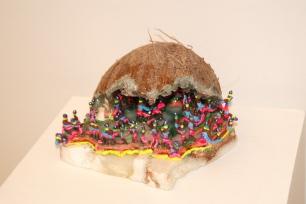 """Appetite,"" Acrylic polymer, acrylic glitter rocks, coconut, tape on granite. ($120)"