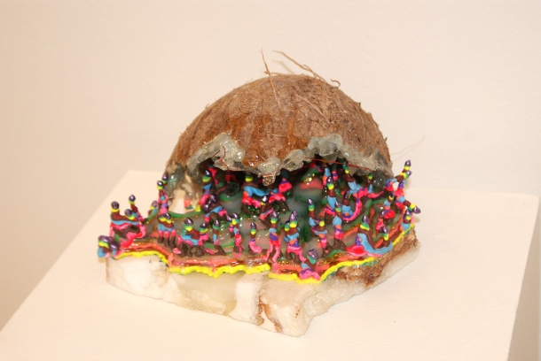 """Appetite,"" Acrylic polymer, acrylic glitter rocks, coconut, tape on granite. ($120)"