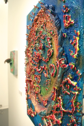 """Glutton's Trench,"" Acrylic, glass, rocks, fired porcelain, glitter, gel medium, acrylic polymer, puff paint on canvas. 29.4""x 21.5"" x4"" ($450)"